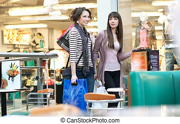 Two cute girl with shoppingbags