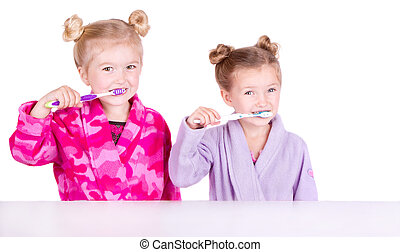 Two cute girls brushing teeth