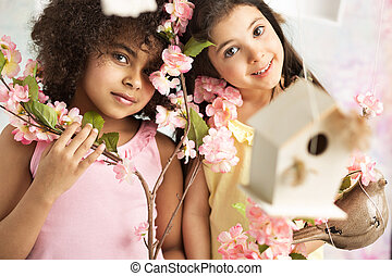Two cute girls with pink flowers