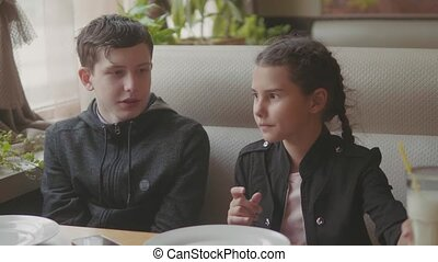 Two Cute kids drinking milkshakes or flavored drinks...