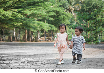 boy and girl walking together and holding hand