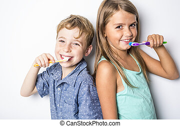 Cute little child brushing teeth, isolated on white