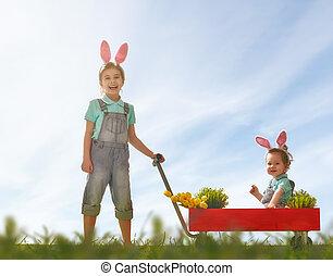 children wear bunny ears - Two cute little children wear...