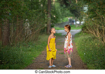 Two cute little girls talking