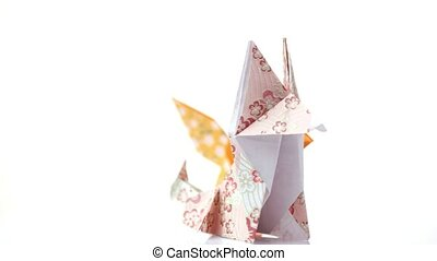 Two cute origami foxes. Colorful animals made from paper....
