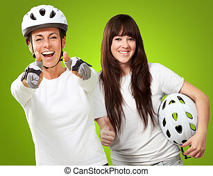 Two Cyclist Woman Showing Thumb Up Sign