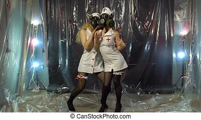 Two dancing girls in gas mask