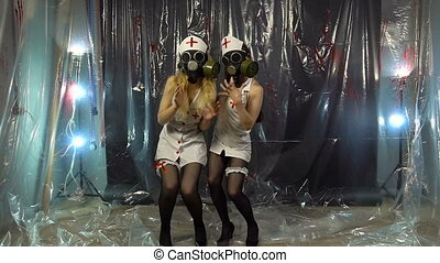 Two dancing nurses in gas mask