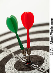 Two darts on a dartboard