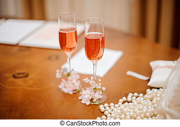 Two decorated glasses of champagne at the registry office -...