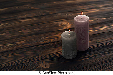 Two decoration pink and gray round candles on wooden background
