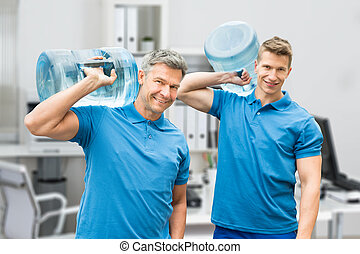 Two Delivery Men Carrying Large Water Bottle