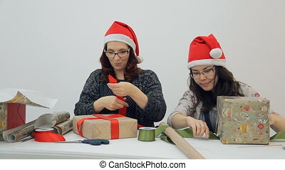 Two designers prepare new year presents for Christmas holidays inside