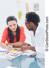 Two designers working on a colour wheel