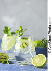 Two detox water, mojito or martini tonic cocktail with kiwi...