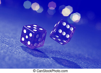 Two dice on blue background.