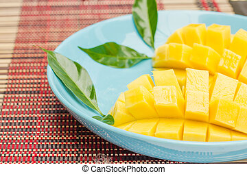 Two diced mangoes in a blue dish