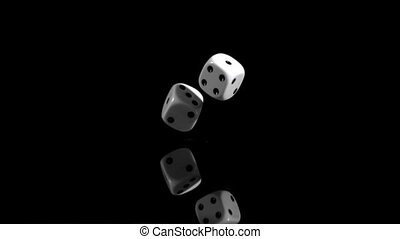 Two dices in super slow motion rebounding against a black background