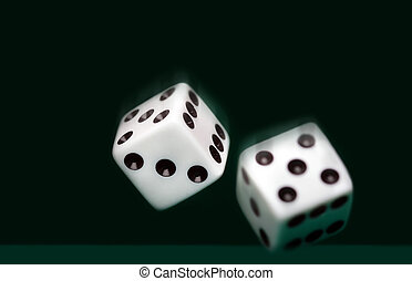 Two dices on green background