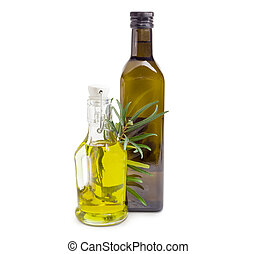 Two different bottles of olive oil with olive branch