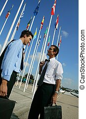 Two diplomats stood by national flags