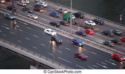 two directional car traffic on bridge in city, top view