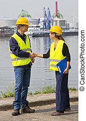 Two Dockers shaking hands - Two dockers, a man and a woman ...