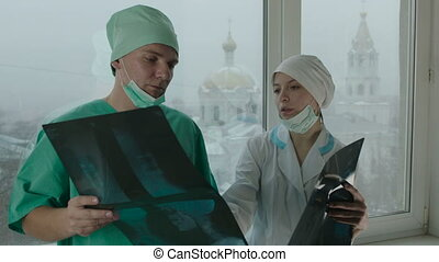 Two Doctors Discussing the Medical Case - Medium shot of two...