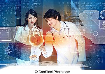 Two doctors examining heart