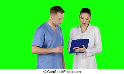 Two doctors explaining about patient. Green screen