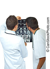 Two doctors men examine magnetic resonance - Back of two...