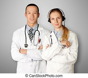 two doctors smiles at camera