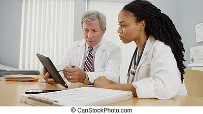 Two doctors working together in the office