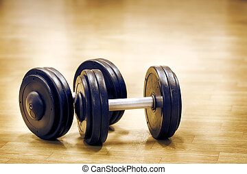 Two dumbbells on the floor