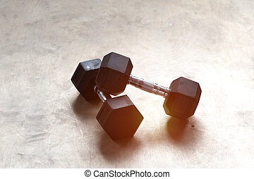 Two dumbbells on the gym floor