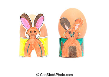 two easter egg holders made by children