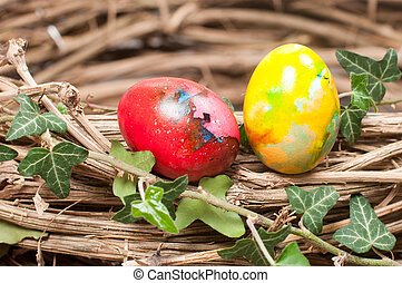 Two Easter eggs in a nest