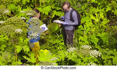 Two ecologists going to the point of research - Two...