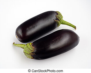 Two eggplants are parallel to each other. Vegetables isolated on a white background. Background with beautiful fresh eggplants.