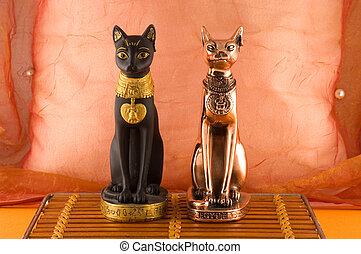 Two egypt statues of a cats