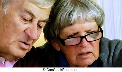 Two elder people discussing - Closeup of retired troubled...