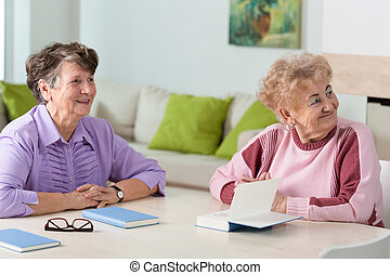 Two elderly women - Two nice elderly women sitting together ...