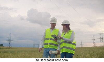 Two Electrical engineer working. Talking and working working...