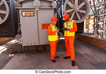 two electrical engineers working together