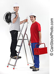Two electrician with step ladder