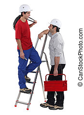 Two electricians having at chat at work