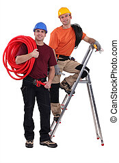 Two electricians working together