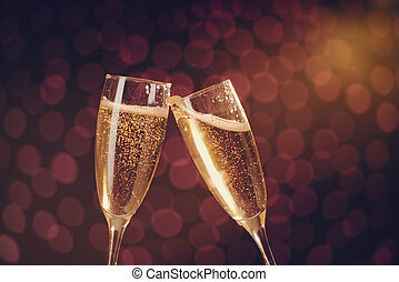 Two elegant champagne glasses making toast