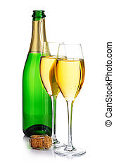 Two elegant champagne glasses on the background of green bottles close-up isolated on  a  white. Festive still life.