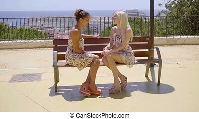 Two elegant female friends enjoy a relaxing chat